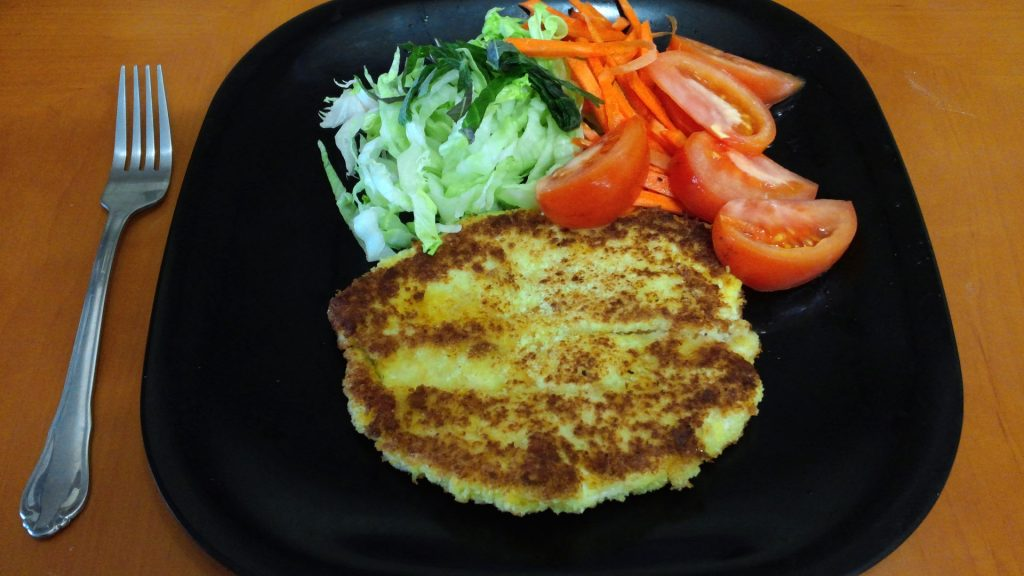 Dish of Chicken cutlet called Katsu served with salad.
