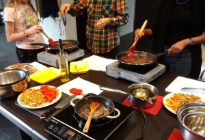 Students make the stir-fried noodle dish, japchae.