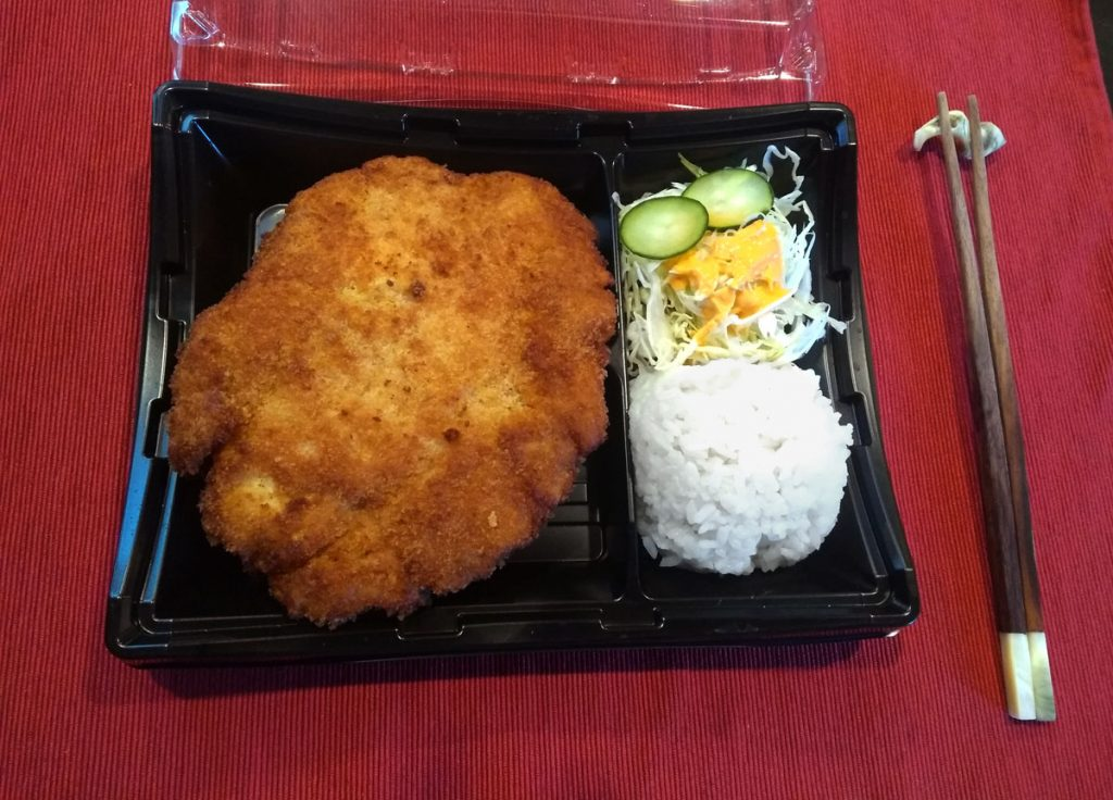 Dish of Chicken cutlet called Katsu served with kimbap.