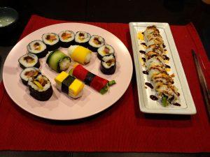 Assortment of Sushi Rolls: Japanese California Roll, Korean Kimbap and Nigiri rice balls.